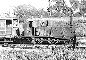 EHLR 0-6-0T No 2 is seen coupled to the brake van whilst being protected from the elements with a tarpaulin