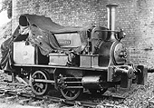 EHLR 0-4-0ST 'Sankey' is protected from the elements both by a tarpaulin as well as standing under the bridge