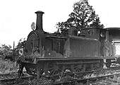 View of EHLR 0-6-0T No 2 ex-LBSCR No 674 'Shadwell' standing in front of the EHLR guards van circa 1930