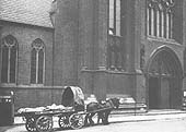 GWR single horse flat trolley No 971 loaded with several carcasses outside St Chads Cathedral