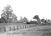 A GWR Diesel Railcar (thought to be Railcar No 2) crosses Bear Lane overbridge north of Henley-in-Arden Station