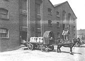 GWR single horse flat trolley being loaded with sacks for distribution at the end of the Inwards Shed and Warehouse