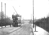 A very early view of new Albany Road with the bridge in the distance whilst an open top tram poses for the camera
