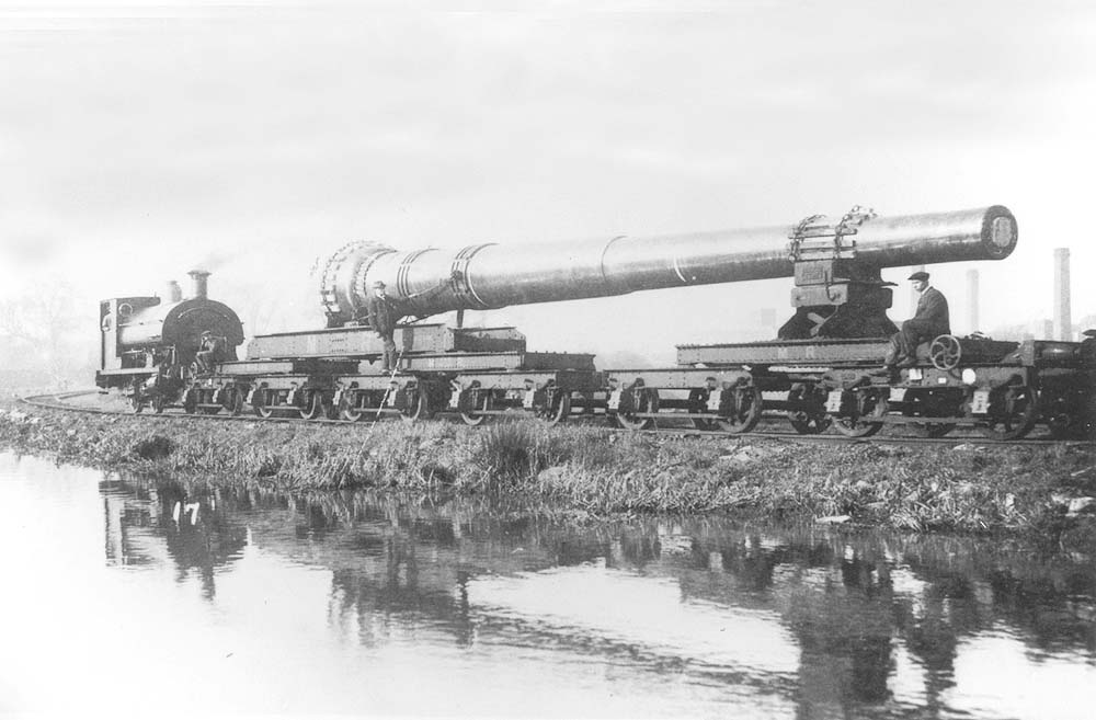 View of the unidentified 0-4-0ST hauling the 15 inch gun barrel along the Foleshill Railway as it passes alongside the Coventry Canal
