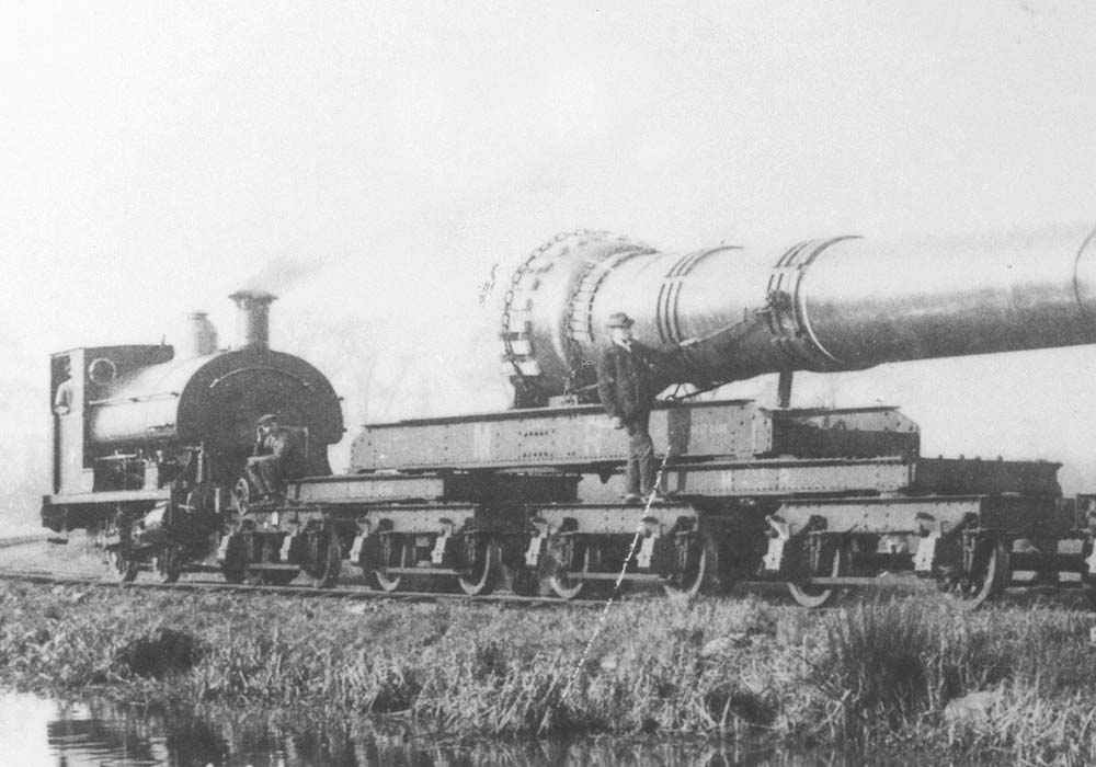 Close up showing the 0-4-0ST at the head of the short train carrying the 15 inch gun barrel and the special four-bogie wagon attached at this end