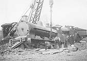 An unidentified LNWR 0-8-0 locomotive is being re-railed after hitting the buffer stops at Folley junction