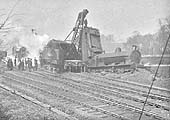View across the junction showing the rear of the unidentified locomotive's tender being hoisted into the air