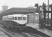 View of a fairly full Coventry Pneumatic Rail-car leaving Nuneaton station on a Coventry service on a wet day on 12th May 1937