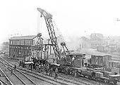 Rugby's brakedown train is seen rerailing mineral wagons alongside Rugby No 5 signal box with the goods yard in the distance