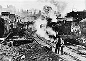 Ex-LMS 2-6-4T No 42421 travels slowly through the accident damaged remains of Sutton Coldfield station