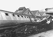 View of one of the carriages and its bogie, twisted and distorted following their derailment