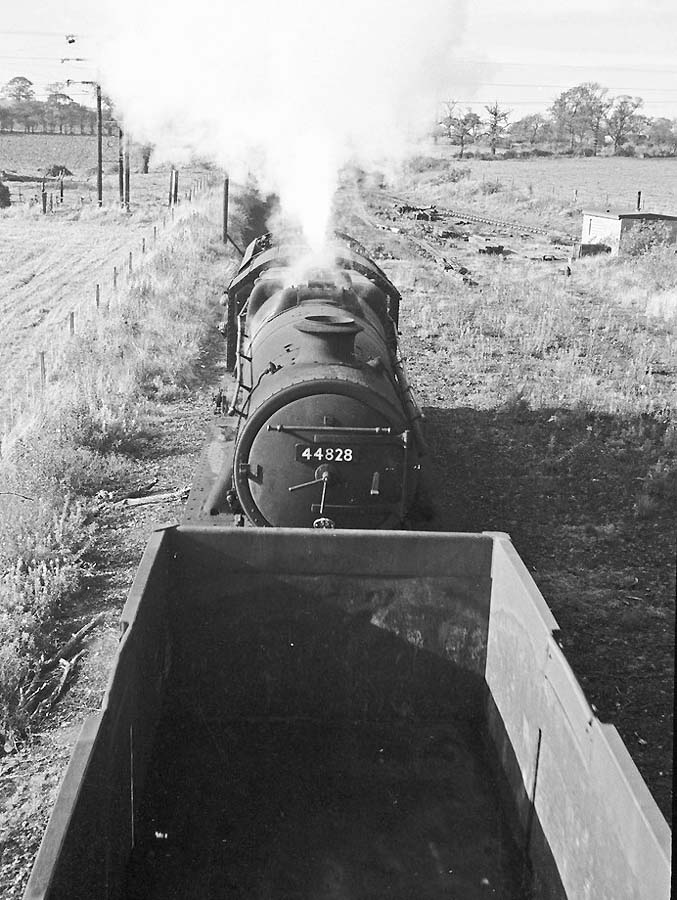 Ex LMS 4-6-0 'Stanier Black Five' No 44828 is seen propelling a rake of wagons towards Baddesley Colliery