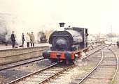 Railway enthusiasts on a platform watch Peckett 0-4-ST, Works No 1722, 'Rocket', steam by on 8th April 1972